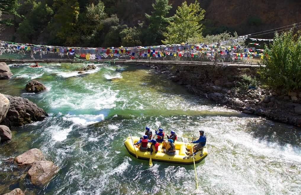 Rafting below the iron bridge at Tachog Lhakhang